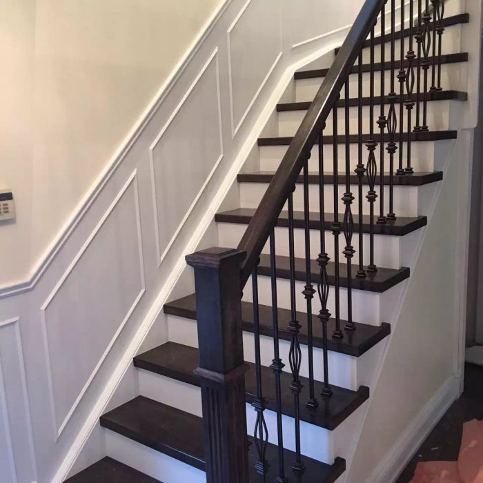 Transitional house with metal railing stairs and wainscoting panel Fuda Homes
