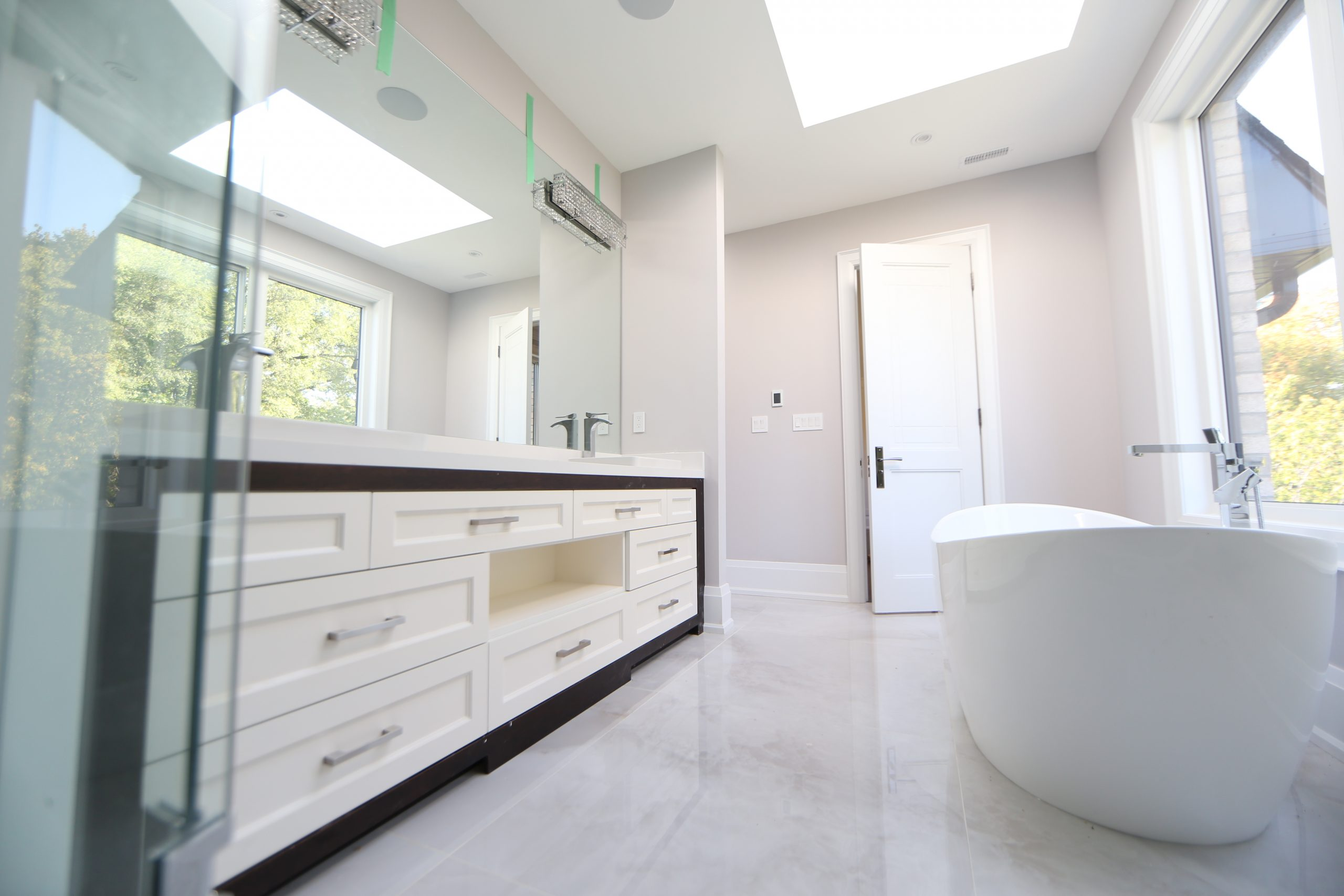 modern bathroom remodel project with frameless shower glass free standing bath tub white tiles scaled 1 Fuda Homes
